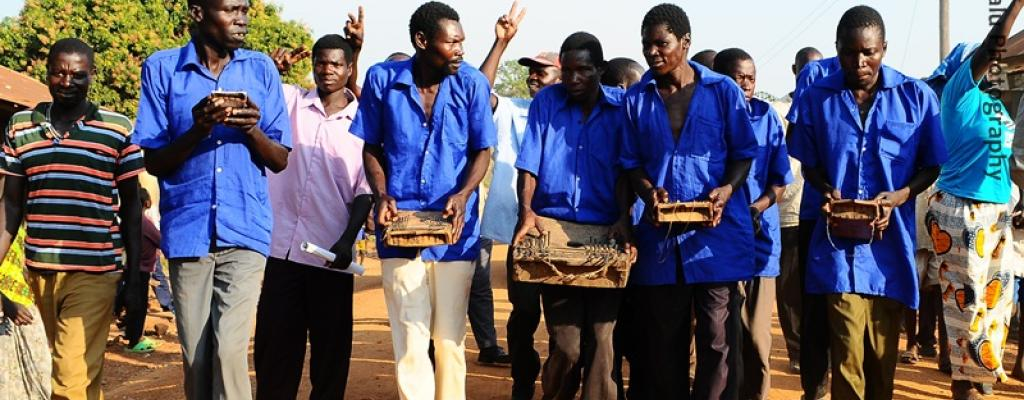 """Men play """"Akongo"""", a traditional music instrument for the Teso people in Serere"""